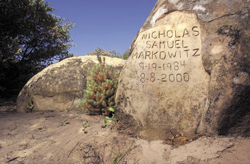 Makeshift headstone carved into a large rock by nicholas markowitz s